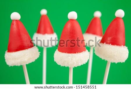 Santa Claus hat cake pops - stock photo