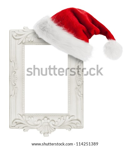 Santa Claus hat hung on the vintage frame - stock photo