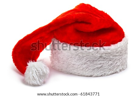 Santa Claus hat, lying on a white. Isolated on white. - stock photo