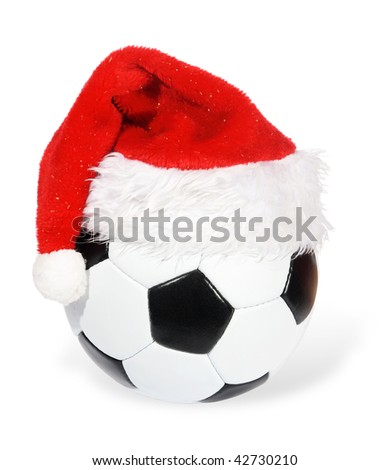 Santa Claus hat on the soccer ball on the white background. (isolated) - stock photo