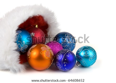 Santa Claus hat with Christmas ornaments isolated on white background