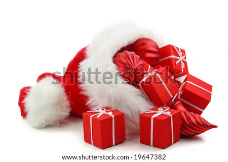 Santa Claus hat with Christmas presents and ornaments isolated on white background - stock photo