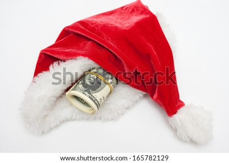 Santa claus hat with dollars - stock photo