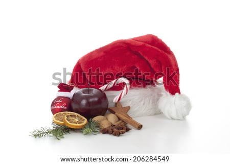 Santa Claus hat with treats and ornament - stock photo