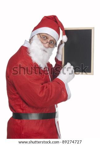 santa claus holding a blackboard - stock photo