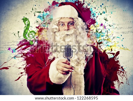 Santa Claus holding a microphone with a colored background - stock photo