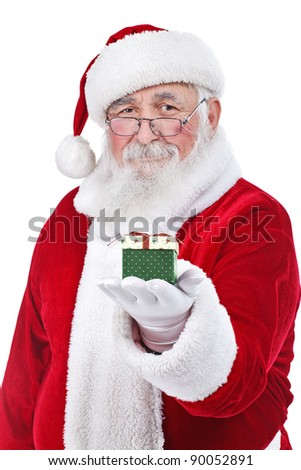 Santa Claus holding and offering a gift on his hand, isolated on white background - stock photo