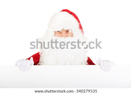 Santa Claus holding empty banner