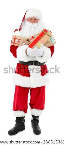 Santa Claus holding gift boxes isolated on white background - stock photo