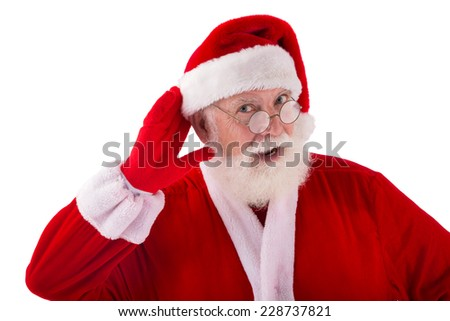 Santa Claus holding hand hear his ear and listening - stock photo