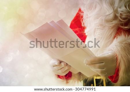 Santa Claus holding letter - stock photo