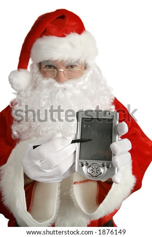 Santa Claus holding out a pocket PC with a message on it.  PC is blank ready for a message.  Shallow depth of field with focus on the PC. - stock photo