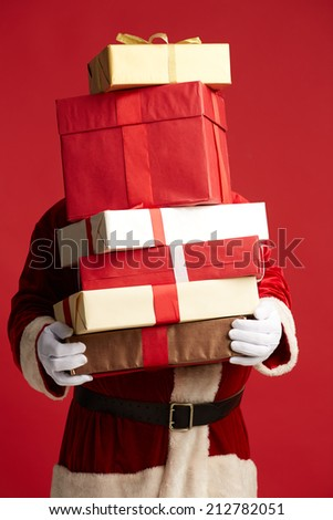 Santa Claus holding pile of giftboxes in isolation - stock photo