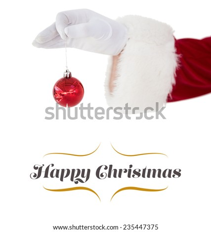 Santa claus holding red bauble against border - stock photo
