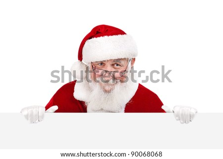 Santa Claus holding white blank banner â??copy space - isolated on white background - stock photo