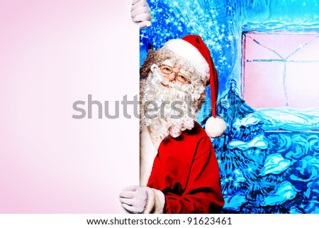 Santa Claus holding white board over Christmas background.