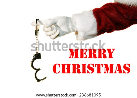 Santa Claus holds a pair of Silver Hand Cuffs on his finger as a Special Christmas Gift to Someone Special. Isolated on white with room for your text. Santa Claus has a Kinky Side. That crazy Santa. - stock photo