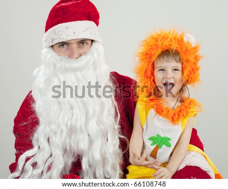 Santa Claus holds the child on hands - stock photo
