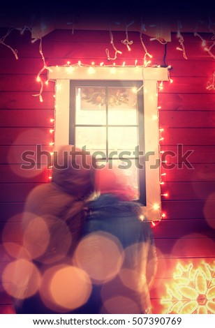 Santa Claus home and people looking through a window