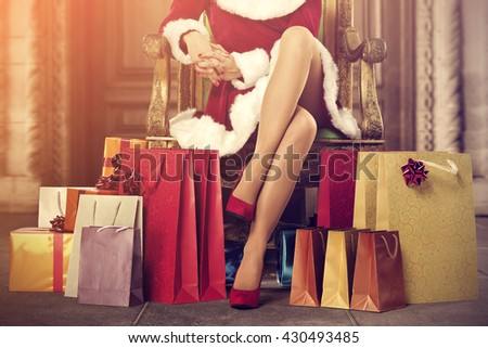 santa claus home interior with old big doors and few xmas bags  - stock photo