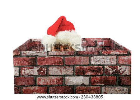 Santa Claus in a Chimney. Santa Claus enters a house through their chimney to deliver gifts to good boys and girls during Christmas. Christmas is enjoyed by people around the world each year, Santa  - stock photo