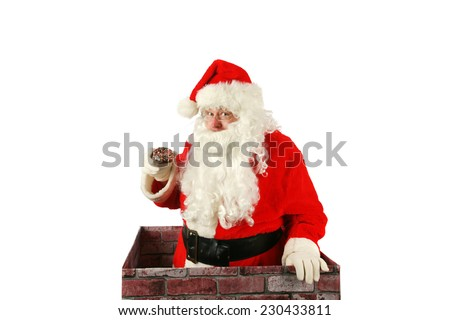 Santa Claus in a Chimney. Santa Claus exits a house through the chimney after delivering presents for all the good boys and girls with a donut that was left for him as a thank you gift. Santa Claus - stock photo