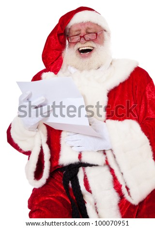 Santa Claus in authentic look having fun reading wish list. All on white background. - stock photo
