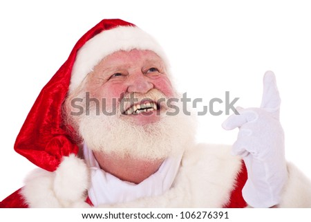 Santa Claus in authentic look pointing with finger. All on white background. - stock photo