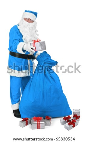 Santa claus in blue costume gives a present on white background - stock photo
