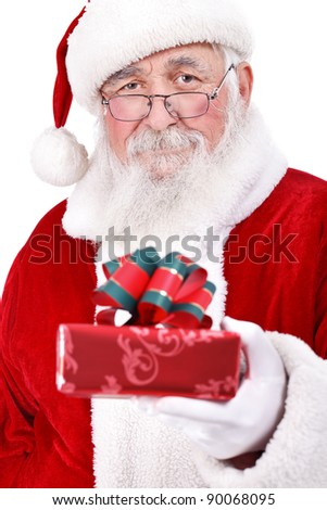 Santa Claus in hand holding gift box with bow, close up, isolated on white background - stock photo