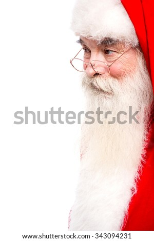 Santa Claus in spectacles looking away - stock photo