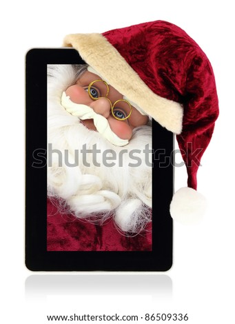Santa Claus in the Christmas tablet - stock photo