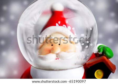 Santa Claus in the snow globe, closeup on Christmas ornament, decorative toy - stock photo