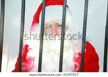 santa claus is behind bars in jail and needs your help to either be bailed out or escape before december 24th or there will no No Christmas for anyone this year - stock photo
