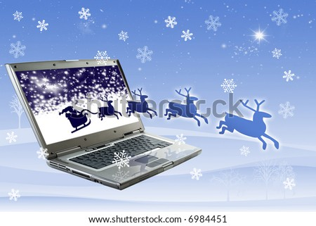 Santa Claus is coming from the monitor - stock photo