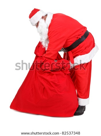 Santa Claus is looking for gifts on white background - stock photo