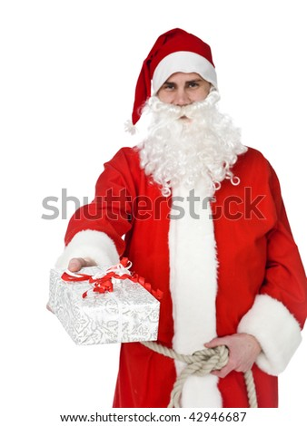 Santa claus is offering a gift isolated on white - stock photo