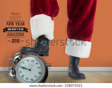 Santa Claus is playing soccer against room with wooden floor - stock photo