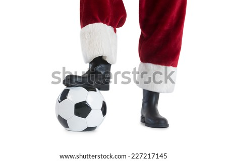 Santa Claus is playing soccer on white background - stock photo