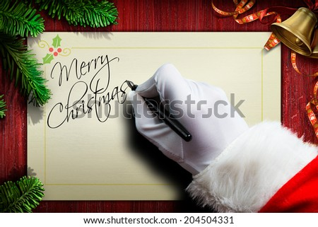 Santa Claus is writing a letter - stock photo