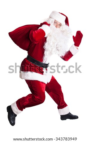 Santa Claus jumping, isolated on white background - stock photo