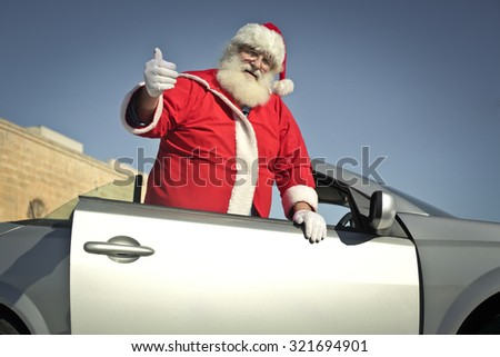Santa Claus jumping on his car - stock photo