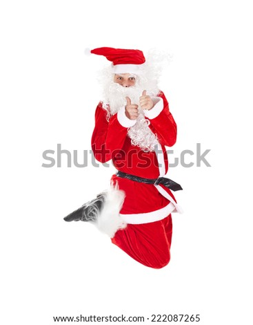 Santa Claus jumping with thumb up sign isolated on white background