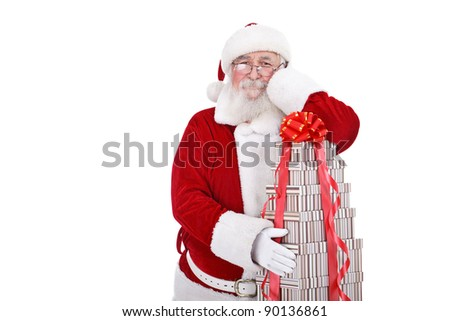 Santa Claus leaning on big stack of gift boxes, isolated on white background - stock photo