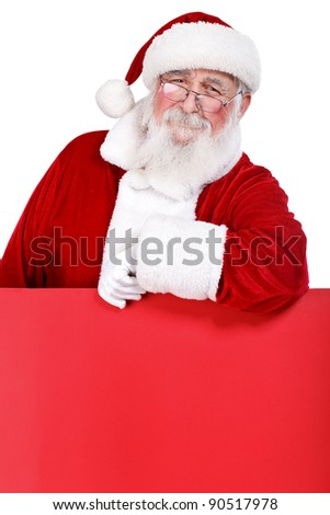 Santa Claus leaning on blank red billboard, isolated on white background - stock photo