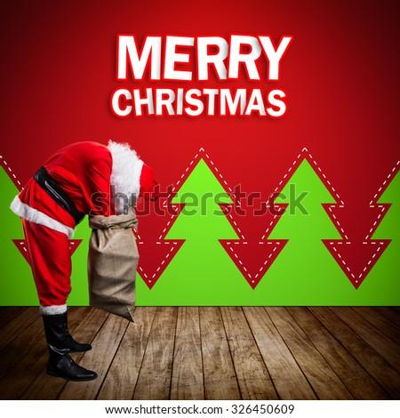 Santa Claus looking into his bag - stock photo