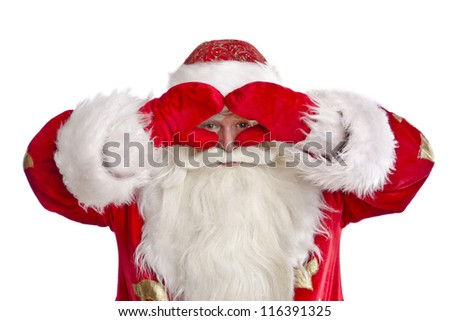 Santa Claus looking into the distance with his hands