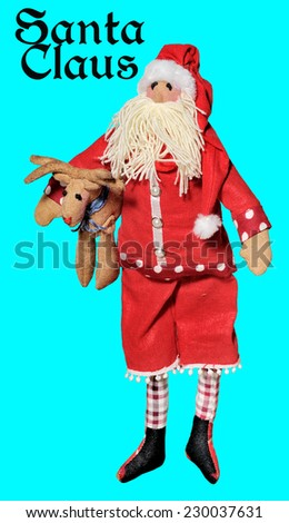 Santa Claus  on a blue background.Doll. - stock photo