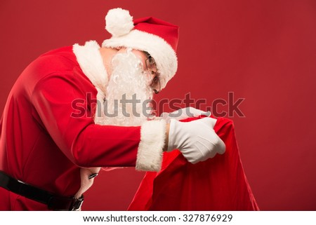 Santa Claus on a red background with gifts