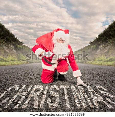 santa claus on a road ready to run. christmas concept - stock photo